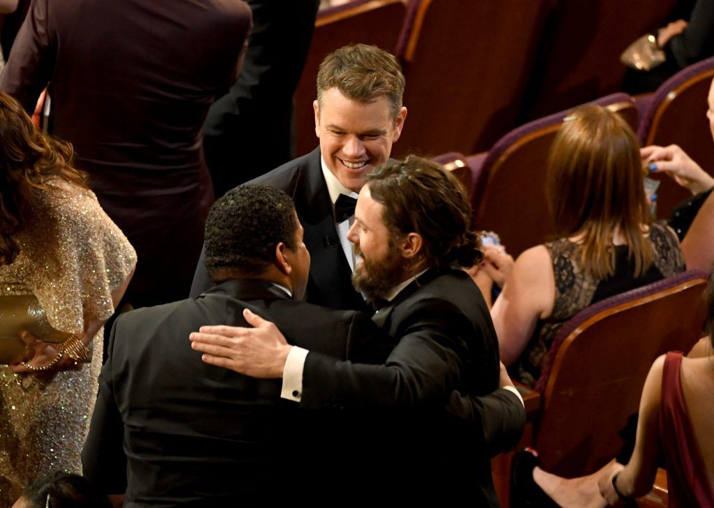 HOLLYWOOD, CA - FEBRUARY 26:  Actor Casey Affleck (R) wins Best Actor for 'Manchester by the Sea' with actor/director Denzel Washington (L) and actor/producer Matt Damon (C) during the 89th Annual Academy Awards at Hollywood & Highland Center on February 26, 2017 in Hollywood, California.  (Photo by Kevin Winter/Getty Images)