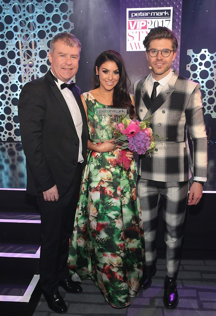 Suzanne Jackson - Most Stylish Woman 2017 is presented with her award by Peter O Rourke -CEO Peter Mark Group with  presenter Darren Kennedy (Right) at the Peter Mark VIP Style Awards 2017 at The Marker Hotel, Dublin. Picture by Brian McEvoy.