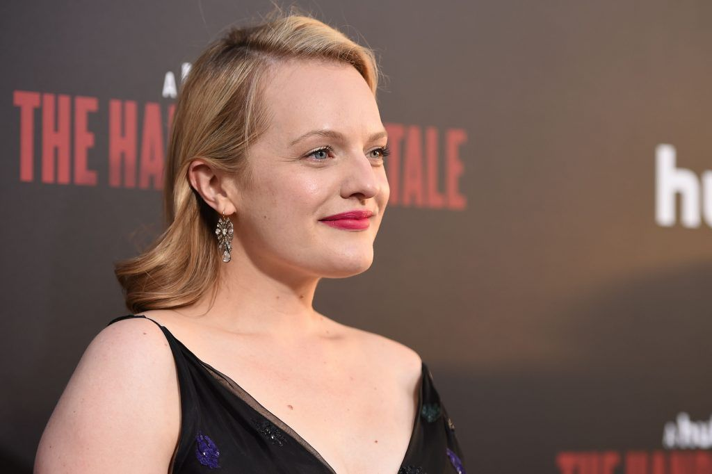 """Actress Elisabeth Moss attends the Los Angeles premiere of Hulus """"The Handmaids Tale,"""" April 25, 2017 at the ArcLight Dome in Hollywood, California. (Photo by ROBYN BECK/AFP/Getty Images)"""