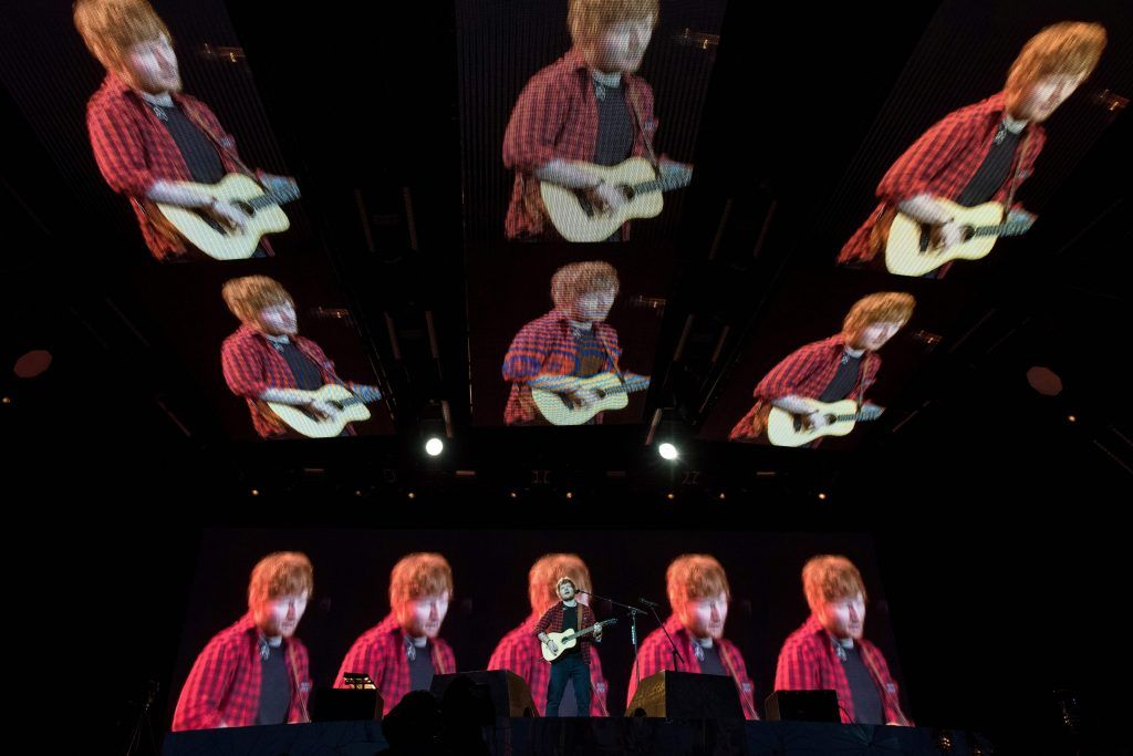 Ed Sheeran performs on the Pyramid Stage at the Glastonbury Festival of Music and Performing Arts on Worthy Farm near the village of Pilton in Somerset, south-west England, on June 25, 2017. (Photo by OLI SCARFF/AFP/Getty Images)