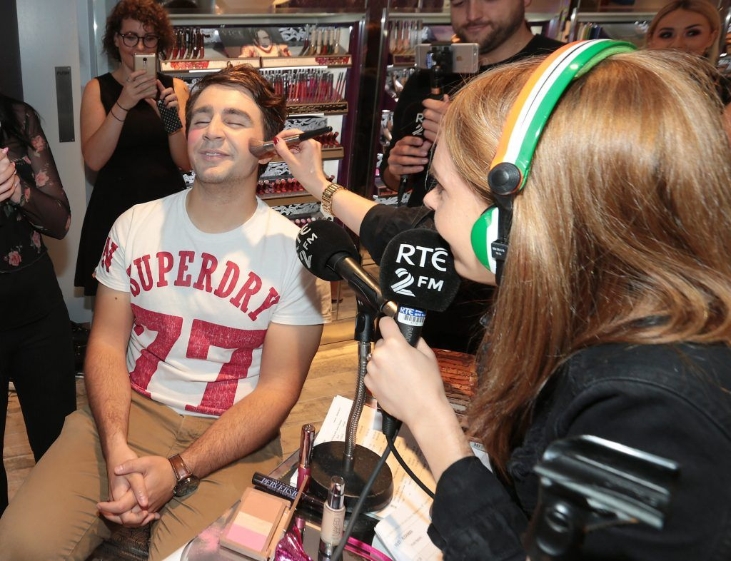 RTE 2FM'S 'The Nicky Byrne Show with Jenny Green' presenter Jenny Green gets to work on  Carl Mullen as they broadcast live from the new Urban Decay Boutique in Grafton Street Dublin. Picture by Brian McEvoy