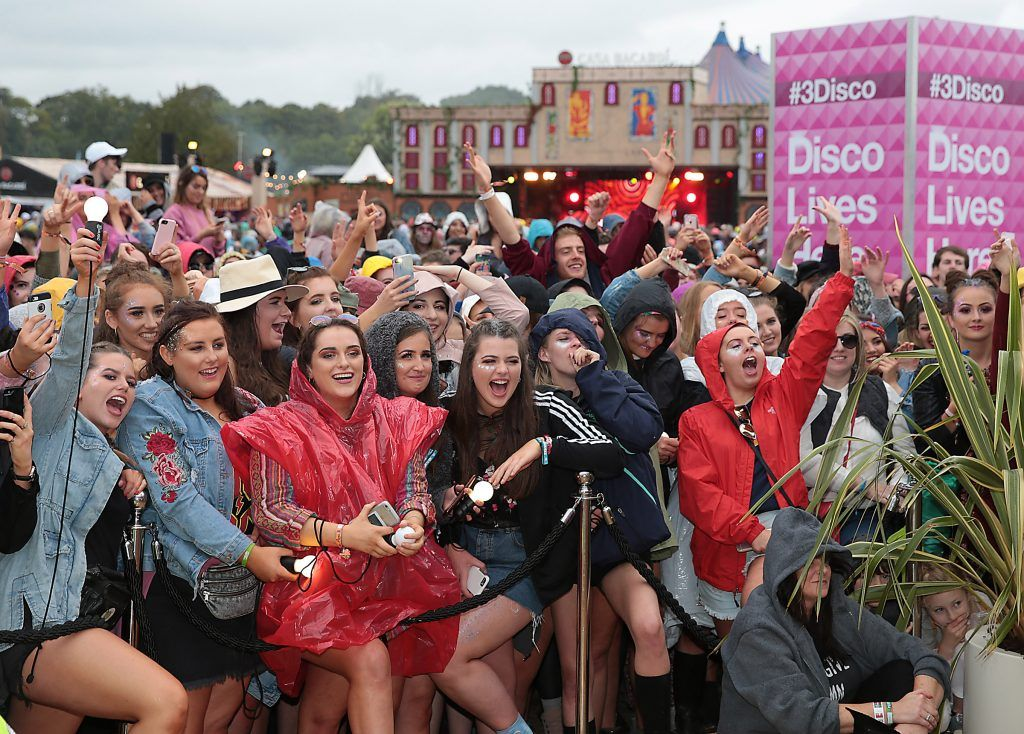 Fand brave the rain to watch Internet sensations James Kavanagh  and Doireann Garrihy as they took part   in the Ultimate #3disco Lip-sync Showdown at the #3Disco area at the sold-out three-day festival Electric Picnic at Stradbally, Co. Laois. Picture: Brian McEvoy