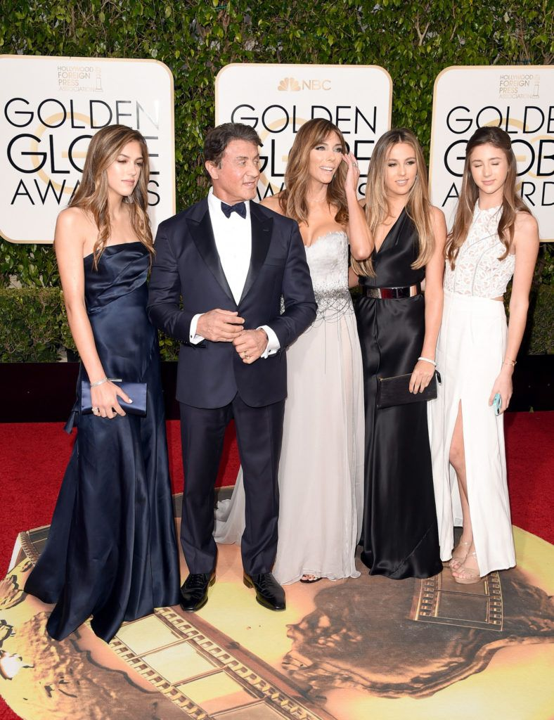 BEVERLY HILLS, CA - JANUARY 10:  Actor Sylvester Stallone (2nd L) with wife Jennifer Flavin, and daughters Sistine, Sophia and Scarlet attend the 73rd Annual Golden Globe Awards held at the Beverly Hilton Hotel on January 10, 2016 in Beverly Hills, California.  (Photo by Jason Merritt/Getty Images)
