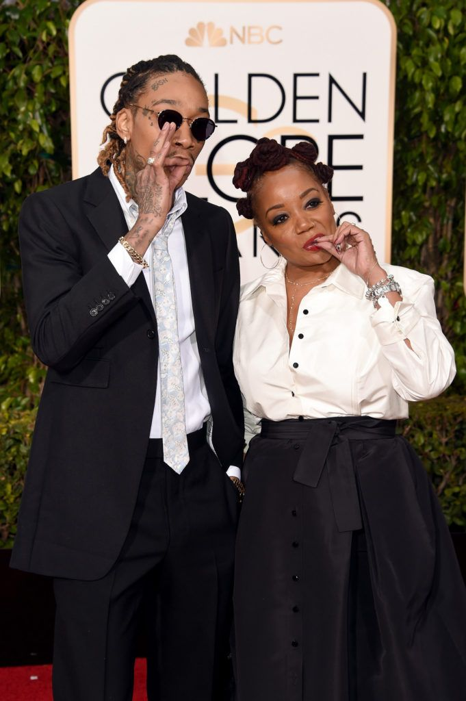 BEVERLY HILLS, CA - JANUARY 10:  Rapper Wiz Khalifa and Peachie Wimbush attend the 73rd Annual Golden Globe Awards held at the Beverly Hilton Hotel on January 10, 2016 in Beverly Hills, California.  (Photo by Jason Merritt/Getty Images)