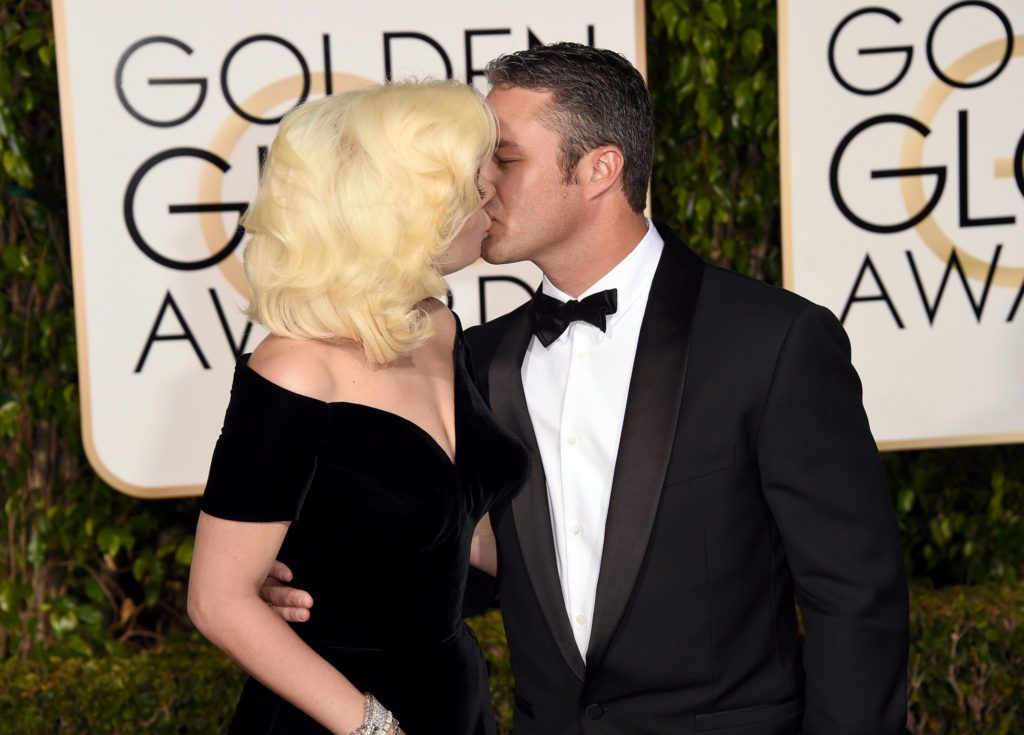 BEVERLY HILLS, CA - JANUARY 10:  Singer/actress Lady Gaga and actor Taylor Kinney attend the 73rd Annual Golden Globe Awards held at the Beverly Hilton Hotel on January 10, 2016 in Beverly Hills, California.  (Photo by Jason Merritt/Getty Images)