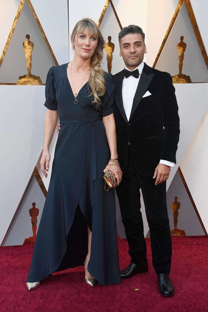 HOLLYWOOD, CA - MARCH 04:  Elvira Lind (L) and Oscar Isaac attend the 90th Annual Academy Awards at Hollywood & Highland Center on March 4, 2018 in Hollywood, California.  (Photo by Frazer Harrison/Getty Images)