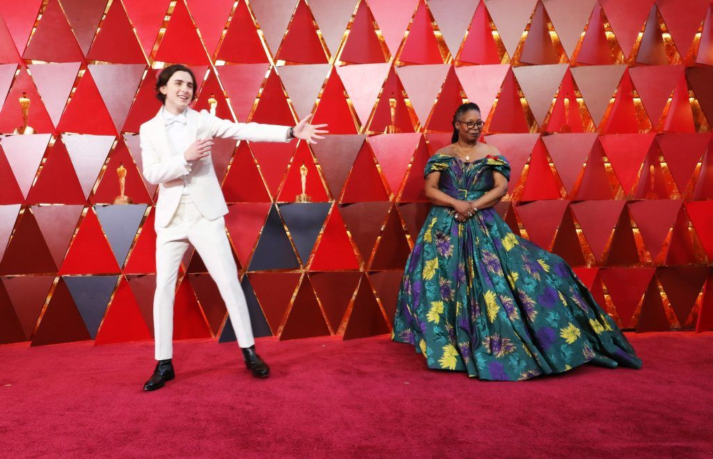 HOLLYWOOD, CA - MARCH 04: Timothee Chalamet (L) and Whoopi Goldberg attend the 90th Annual Academy Awards at Hollywood & Highland Center on March 4, 2018 in Hollywood, California.  (Photo by Neilson Barnard/Getty Images)