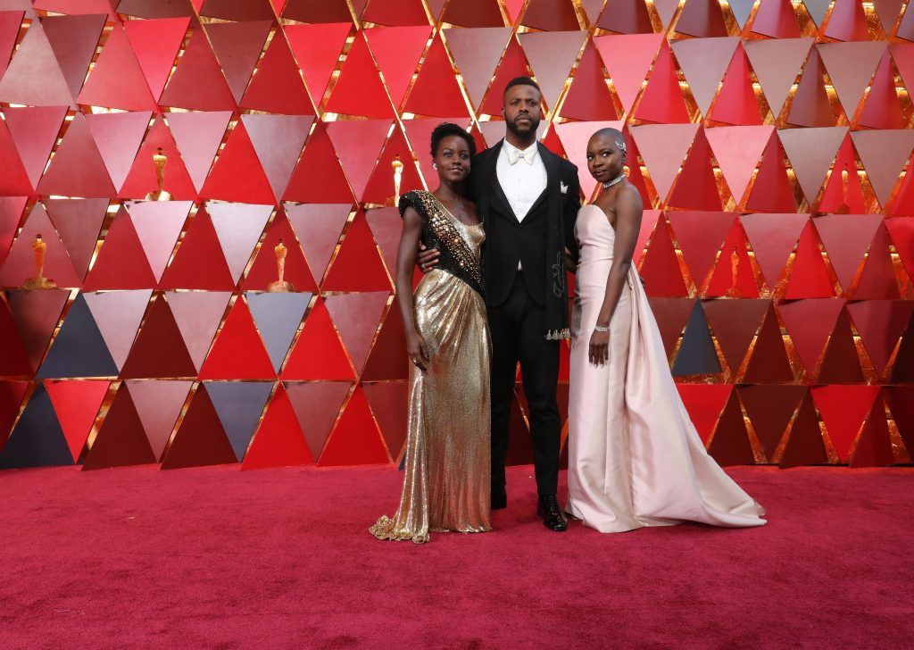 HOLLYWOOD, CA - MARCH 04:  (L-R) Lupita Nyong'o,Winston Duke and Danai Gurira attend the 90th Annual Academy Awards at Hollywood & Highland Center on March 4, 2018 in Hollywood, California.  (Photo by Neilson Barnard/Getty Images)