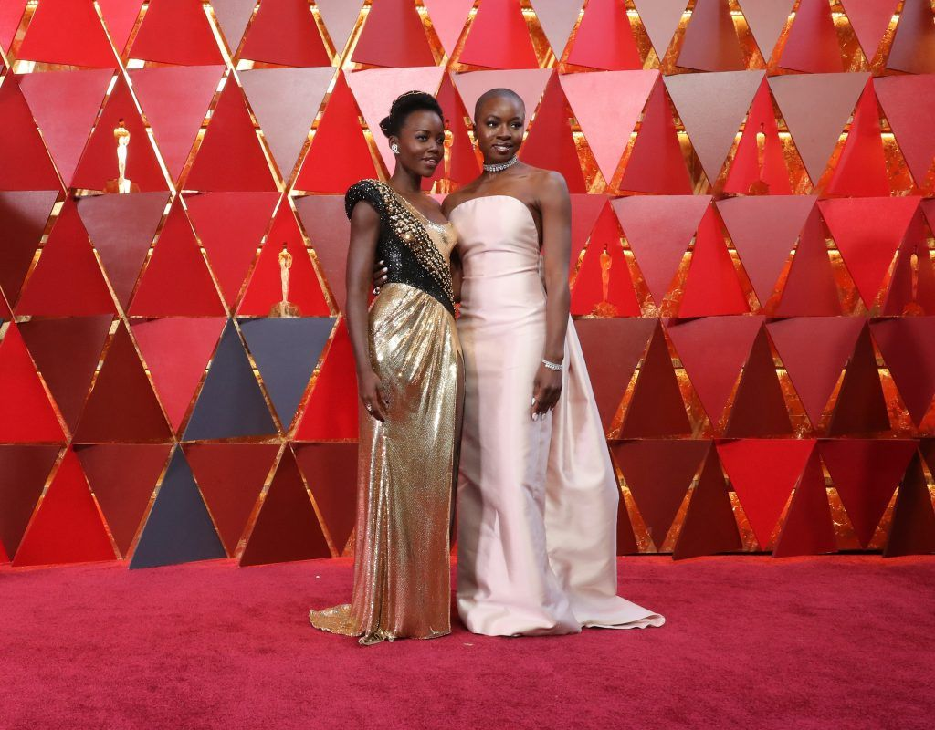 HOLLYWOOD, CA - MARCH 04:  Lupita Nyong'o  (L) and Danai Gurira attend the 90th Annual Academy Awards at Hollywood & Highland Center on March 4, 2018 in Hollywood, California.  (Photo by Neilson Barnard/Getty Images)