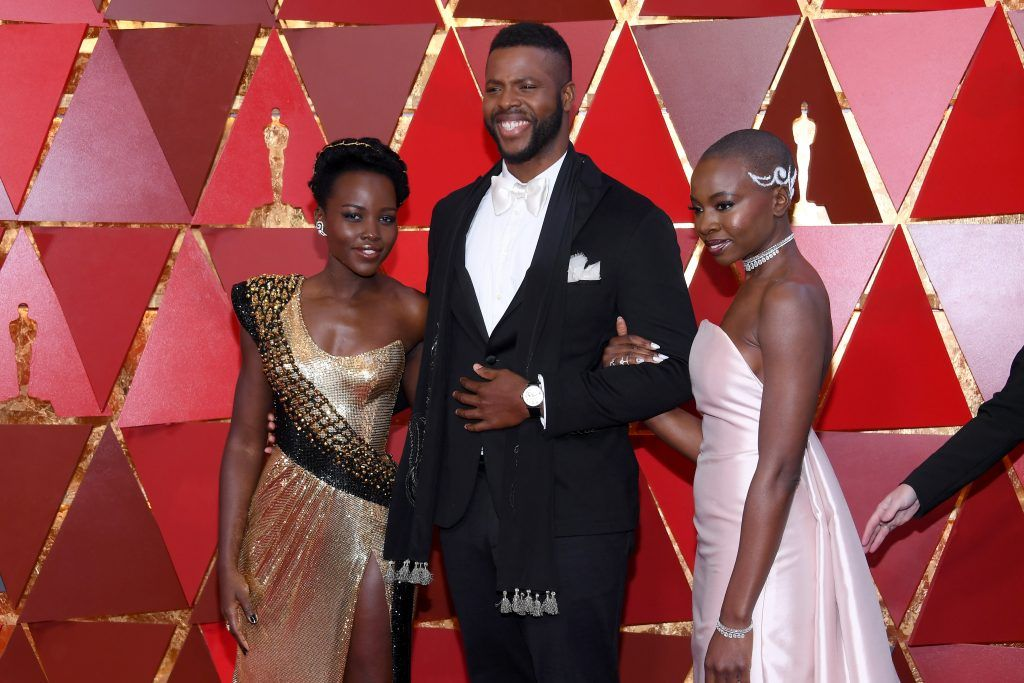 HOLLYWOOD, CA - MARCH 04:  (L-R) Lupita Nyong'o, Winston Duke, and Danai Gurira attends the 90th Annual Academy Awards at Hollywood & Highland Center on March 4, 2018 in Hollywood, California.  (Photo by Kevork Djansezian/Getty Images)