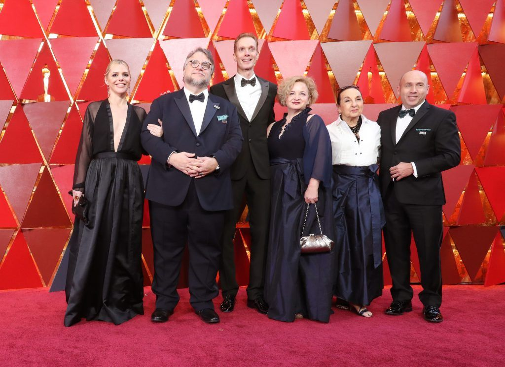 """HOLLYWOOD, CA - MARCH 04: The cast and crew of """"The Shape of Water"""" attends the 90th Annual Academy Awards at Hollywood & Highland Center on March 4, 2018 in Hollywood, California.  (Photo by Neilson Barnard/Getty Images)"""
