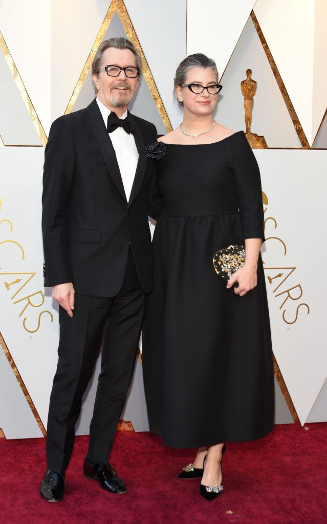 Actor Gary Oldman (L) and his wife arrive for the 90th Annual Academy Awards on March 4, 2018, in Hollywood, California.  / AFP PHOTO / VALERIE MACON        (Photo credit should read VALERIE MACON/AFP/Getty Images)