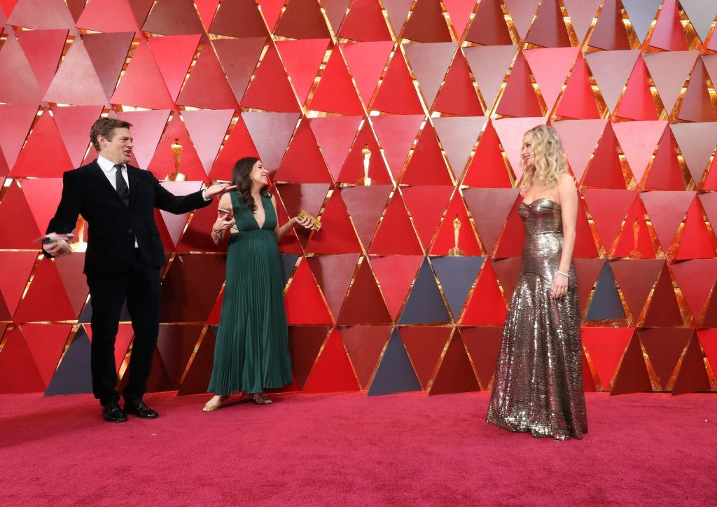 HOLLYWOOD, CA - MARCH 04:  Jennifer Lawrence (R) attends the 90th Annual Academy Awards at Hollywood & Highland Center on March 4, 2018 in Hollywood, California.  (Photo by Neilson Barnard/Getty Images)
