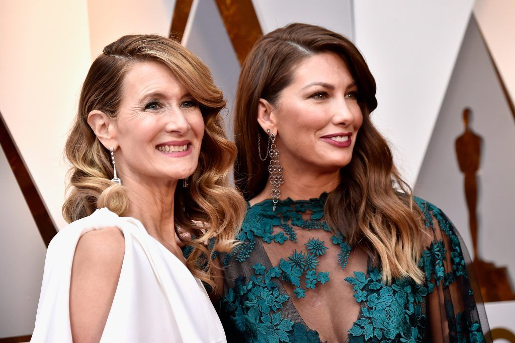 HOLLYWOOD, CA - MARCH 04:  Laura Dern (L) and guest attend the 90th Annual Academy Awards at Hollywood & Highland Center on March 4, 2018 in Hollywood, California.  (Photo by Frazer Harrison/Getty Images)