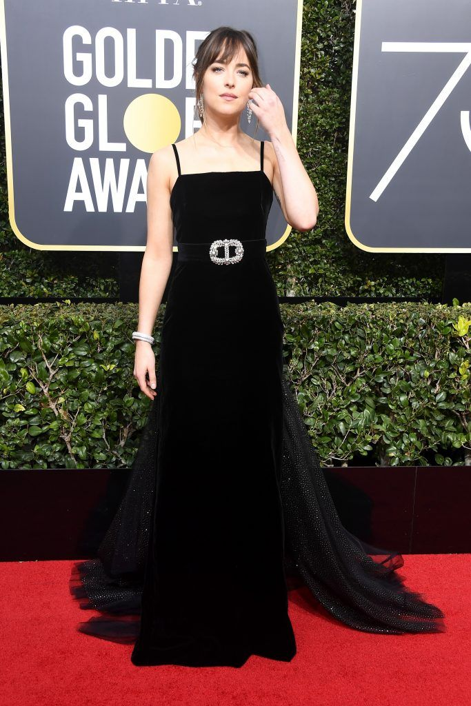 BEVERLY HILLS, CA - JANUARY 07:  Actor Dakota Johnson attends The 75th Annual Golden Globe Awards at The Beverly Hilton Hotel on January 7, 2018 in Beverly Hills, California.  (Photo by Frazer Harrison/Getty Images)