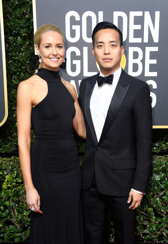 BEVERLY HILLS, CA - JANUARY 07:  Director Alan Yang (R) and guest attend The 75th Annual Golden Globe Awards at The Beverly Hilton Hotel on January 7, 2018 in Beverly Hills, California.  (Photo by Frazer Harrison/Getty Images)