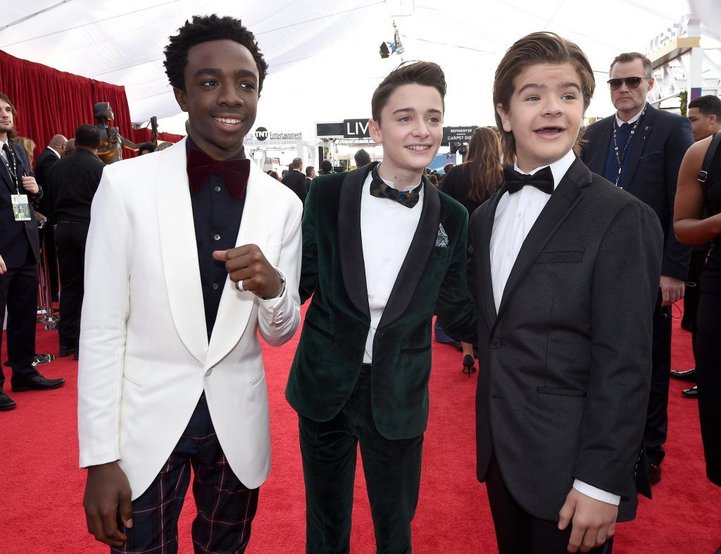 LOS ANGELES, CA - JANUARY 21:  Actors Caleb McLaughlin (L), Noah Schnapp; and Gaten Matarazzo attend the 24th Annual Screen ActorsGuild Awards at The Shrine Auditorium on January 21, 2018 in Los Angeles, California.  (Photo by Kevork Djansezian/Getty Images)