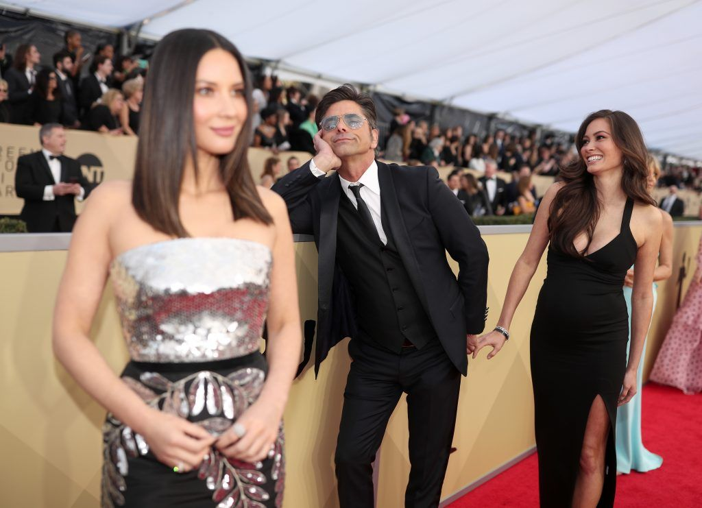 LOS ANGELES, CA - JANUARY 21:  Actors John Stamos, Olivia Munn and Caitlin McHugh attends the 24th Annual Screen Actors Guild Awards at The Shrine Auditorium on January 21, 2018 in Los Angeles, California. 27522_010  (Photo by Christopher Polk/Getty Images for Turner Image)
