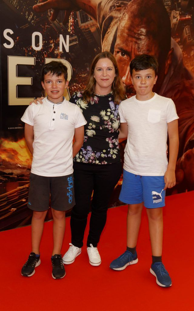 Samuel (12) , and Jeanne and James (12) Scullion pictured at the Universal Pictures special preview screening of SKYSCRAPER, at Odeon Point Square, Dublin. Picture: Andres Poveda