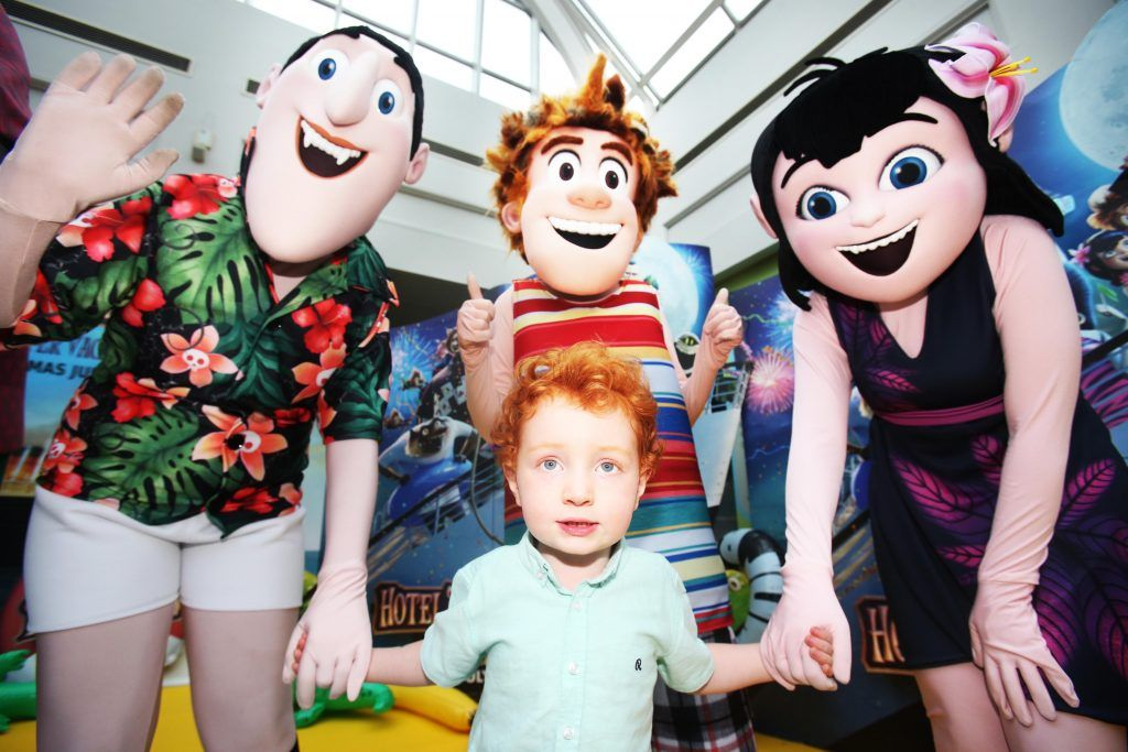 Conor McStay 4yrs from Firhouse meets with some of the Characters from Hotel Transylvania 3 at the mulitimedia screening in Omniplex Rathmines. Photo: Leon Farrell.