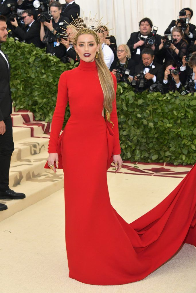 NEW YORK, NY - MAY 07:  Amber Heard attends the Heavenly Bodies: Fashion & The Catholic Imagination Costume Institute Gala at The Metropolitan Museum of Art on May 7, 2018 in New York City.  (Photo by Neilson Barnard/Getty Images)