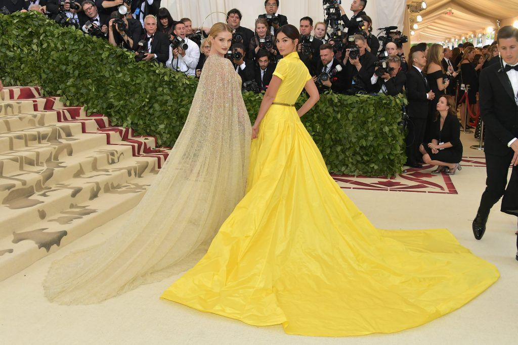 NEW YORK, NY - MAY 07:  Rosie Huntington-Whiteley and Lily Aldridge attend the Heavenly Bodies: Fashion & The Catholic Imagination Costume Institute Gala at The Metropolitan Museum of Art on May 7, 2018 in New York City.  (Photo by Neilson Barnard/Getty Images)