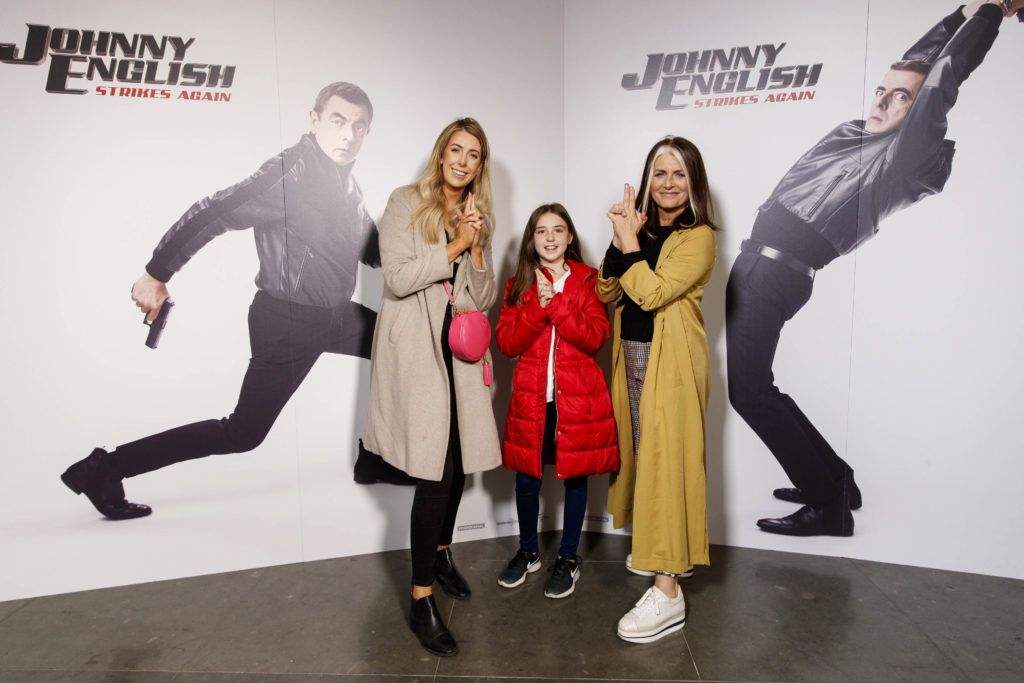 Ciara Darcy with daughter Abbie (9) and Cathy O'Connor pictured at a special preview screening of Johnny English Strikes Again at ODEON Point Village, Dublin. Picture Andres Poveda