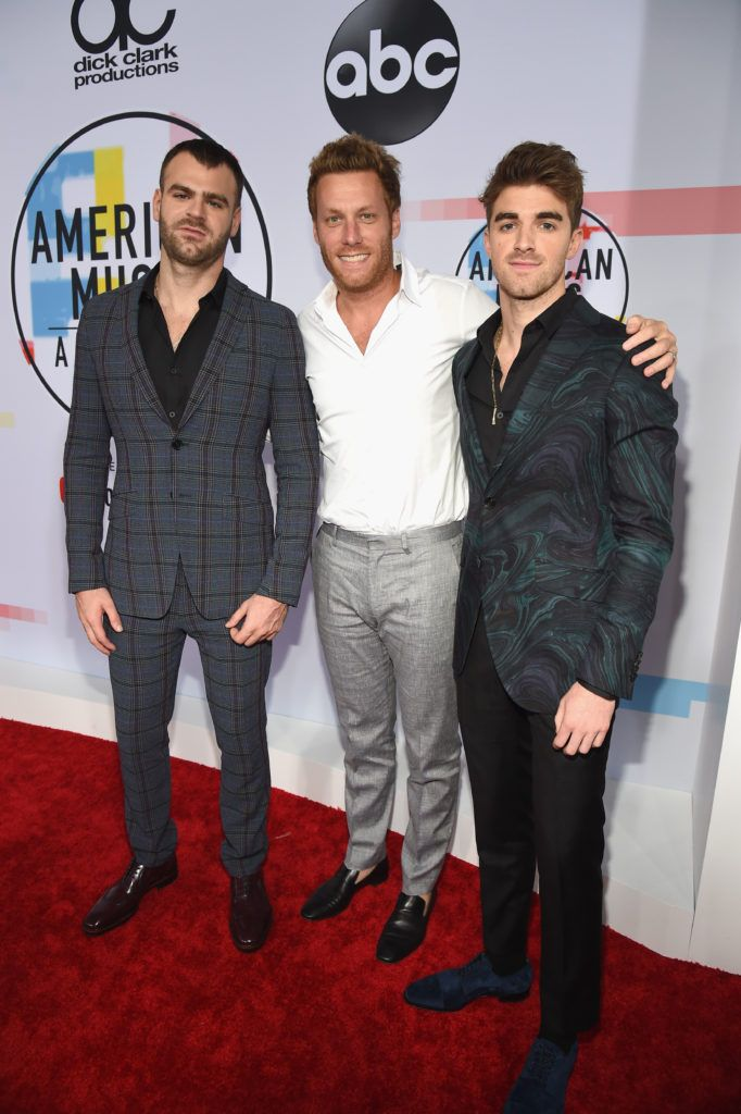 Alex Pall (L) and Andrew Taggart (R) of The Chainsmokers attend the 2018 American Music Awards at Microsoft Theater on October 9, 2018 in Los Angeles, California.  (Photo by Kevin Mazur/Getty Images For dcp)