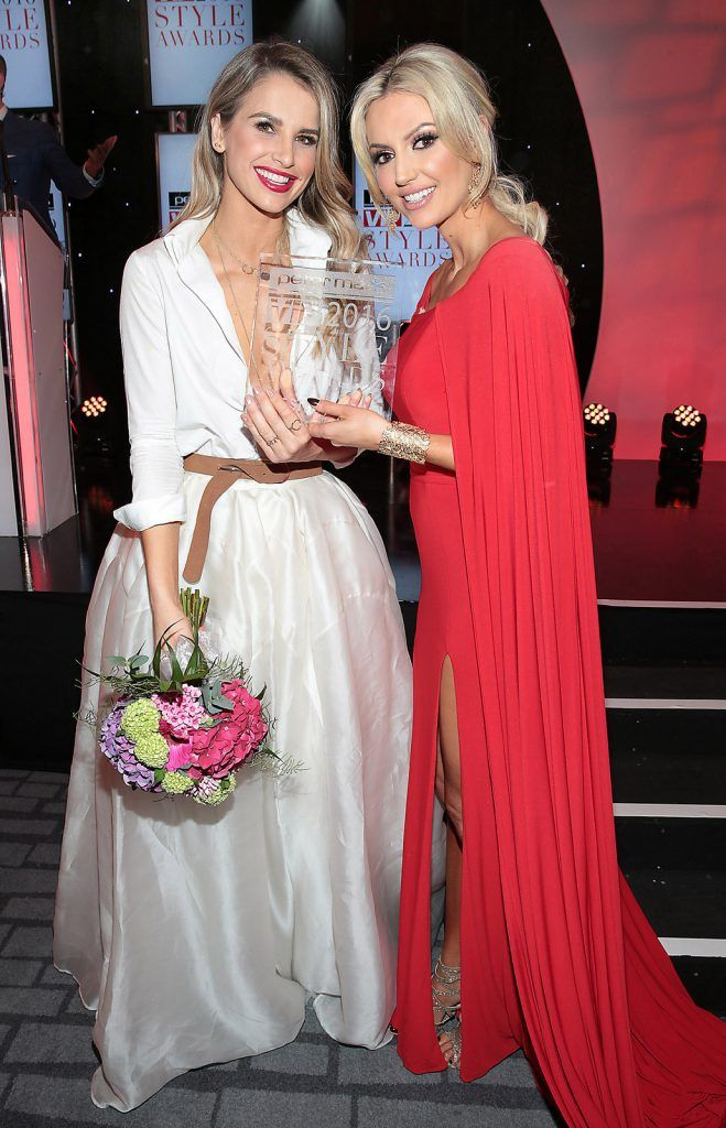 Vogue Williams (Left) is presented with her prize for most stylish woman  by Rosanna Davison at The Peter Mark Vip Style Awards at The Marker Hotel in Dublin..Picture:Brian McEvoy
