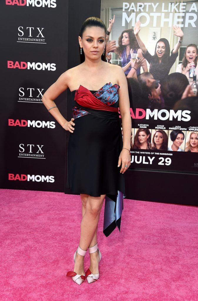"Actress Mila Kunis attends the premiere of STX Entertainment's ""Bad Moms"" at Mann Village Theatre on July 26, 2016 (Photo by Frazer Harrison/Getty Images)"