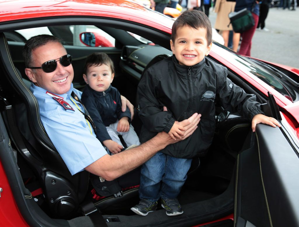 Greg Hayden with children Zac Hayden and Ethan Hayden at the start of the Cannonball Supercar 2016 event at Point Village Dublin. Proceeds from this year's Supercar spectacle will go to the Pieta House charity (Photo by Brian McEvoy).