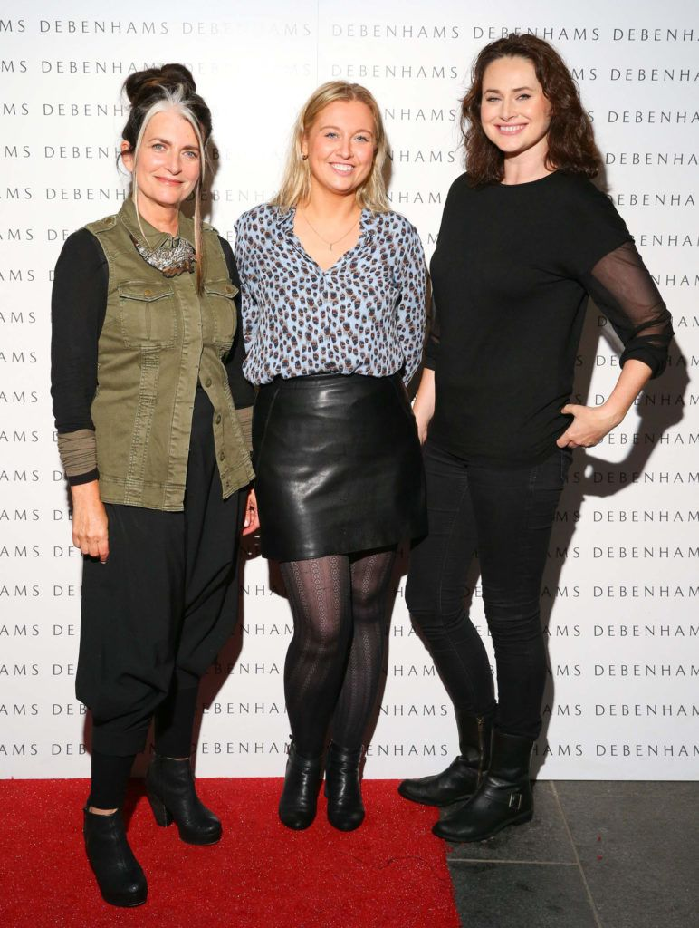 Pictured are Cathy O'Connor, Andrea Kissane and Corina Grant as Debenhams showcased their AW16 collection last night in the stunning back drop of Christ Church Catherdral. Guests sipped on Mc Guigan Frizzante as 1st Options Model took to the Crypt catwalk for a show styled by top stylist Sonja Mohlich. Pic: Marc O'Sullivan