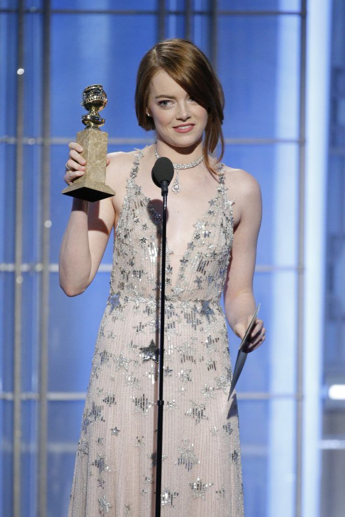"BEVERLY HILLS, CA - JANUARY 08: In this handout photo provided by NBCUniversal, Emma Stone accepts the award for Best Actress in a Motion Picture - Musical or Comedy for her role in ""La La Land"" onstage during the 74th Annual Golden Globe Awards at The Beverly Hilton Hotel on January 8, 2017 in Beverly Hills, California. (Photo by Paul Drinkwater/NBCUniversal via Getty Images)"