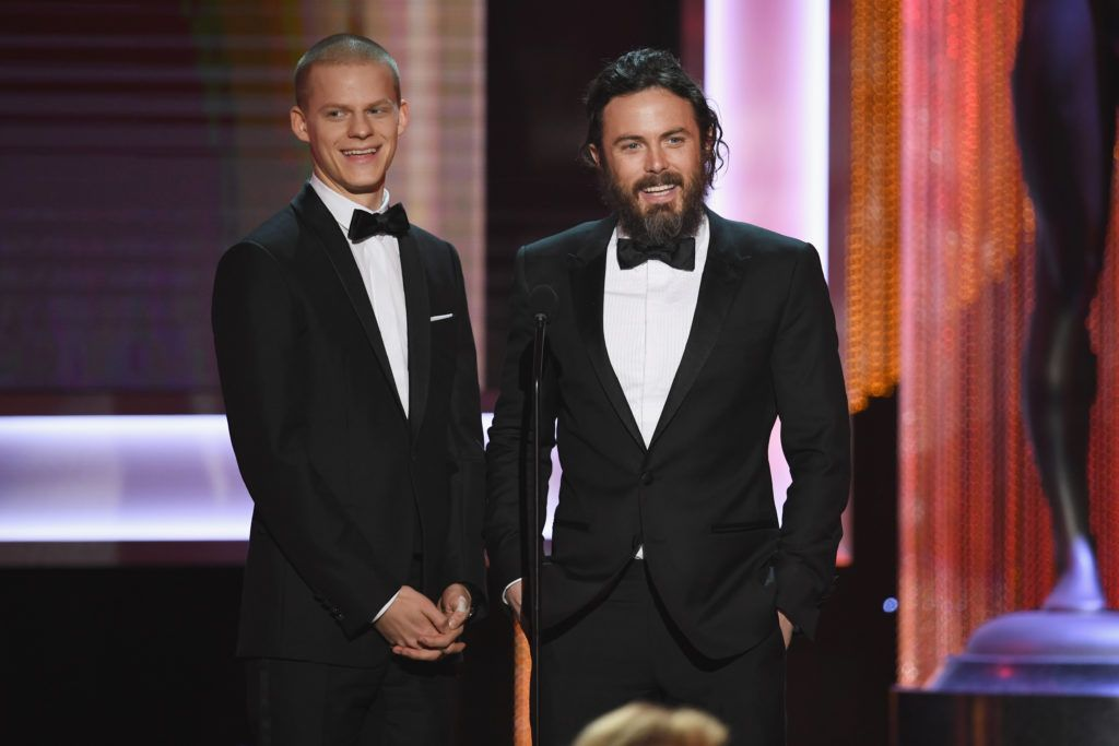 LOS ANGELES, CA - JANUARY 29:  Actor Lucas Hedges (L) and actor/director Casey Affleck speak onstage during The 23rd Annual Screen Actors Guild Awards at The Shrine Auditorium on January 29, 2017 in Los Angeles, California. 26592_014  (Photo by Kevin Winter/Getty Images )