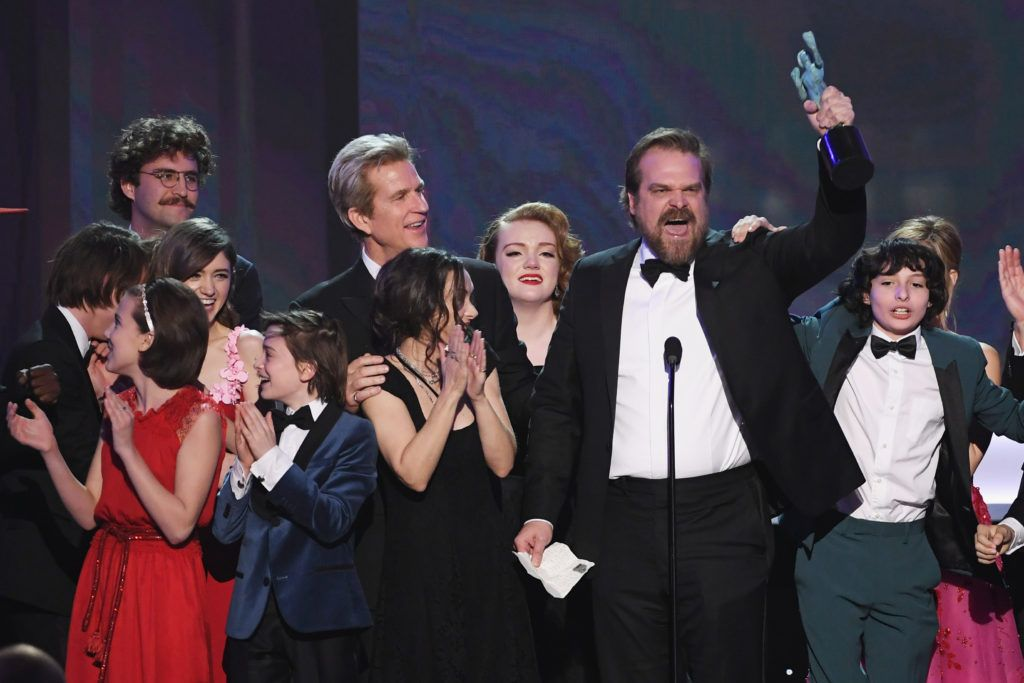 LOS ANGELES, CA - JANUARY 29:  (L-R) Actors Millie Bobby Brown, Natalia Dyer, John Paul Reynolds, Noah Schnapp, Winona Ryder, Matthew Modine, Shannon Purser, David Harbour, and Finn Wolfhard of 'Stranger Things' accept Outstanding Performance by an Ensemble in a Drama Series onstage during The 23rd Annual Screen Actors Guild Awards at The Shrine Auditorium on January 29, 2017 in Los Angeles, California. 26592_014  (Photo by Kevin Winter/Getty Images )