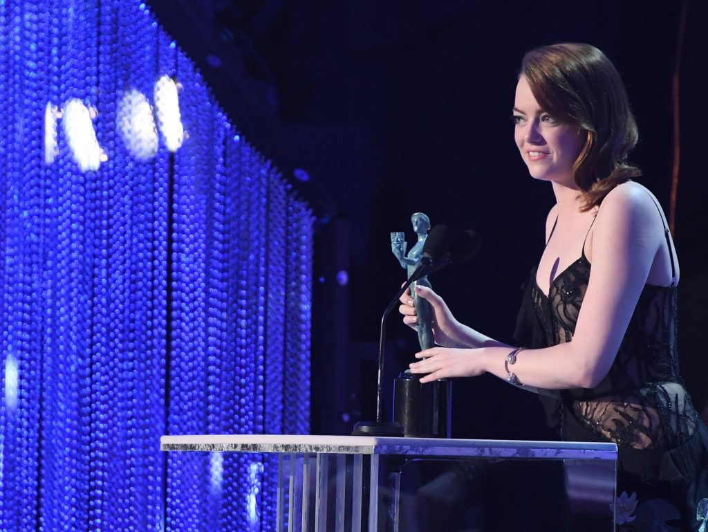 "LOS ANGELES, CA - JANUARY 29:  Actor Emma Stone accepts the award for ""A Female Actor in a Leading Role"" onstage during The 23rd Annual Screen Actors Guild Awards at The Shrine Auditorium on January 29, 2017 in Los Angeles, California. 26592_009  (Photo by Dimitrios Kambouris/Getty Images for TNT)"