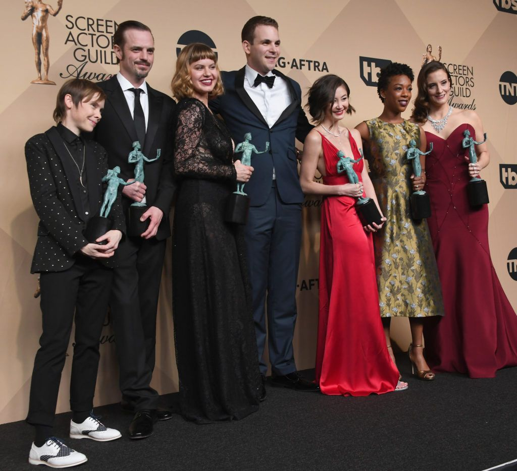LOS ANGELES, CA - JANUARY 29:  (L-R) Actors Abigail Savage, James McMenamin, Emily Althaus, Alan Aisenberg, Kimiko Glenn, Samira Wiley, and Julie Lake, co-winners of the Outstanding Performance by an Ensemble in a Comedy Series award for 'Orange Is the New Black,' pose in the press room during the 23rd Annual Screen Actors Guild Awards at The Shrine Expo Hall on January 29, 2017 in Los Angeles, California.  (Photo by Alberto E. Rodriguez/Getty Images)
