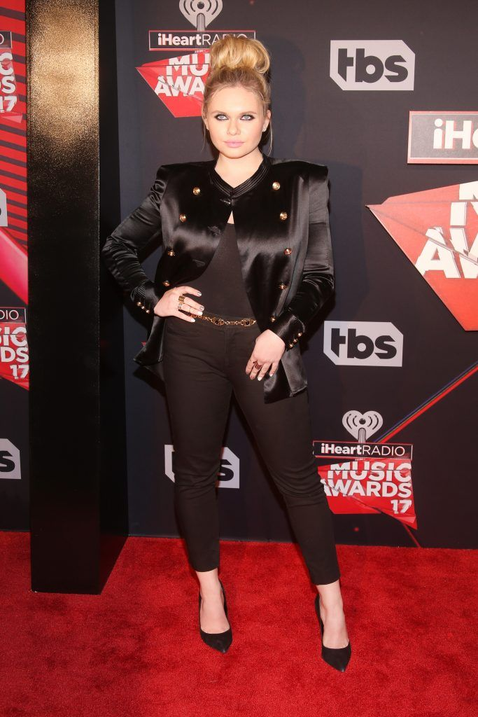 Singer Alli Simpson attends the 2017 iHeartRadio Music Awards which broadcast live on Turner's TBS, TNT, and truTV at The Forum on March 5, 2017 in Inglewood, California.  (Photo by Jesse Grant/Getty Images for iHeartMedia)