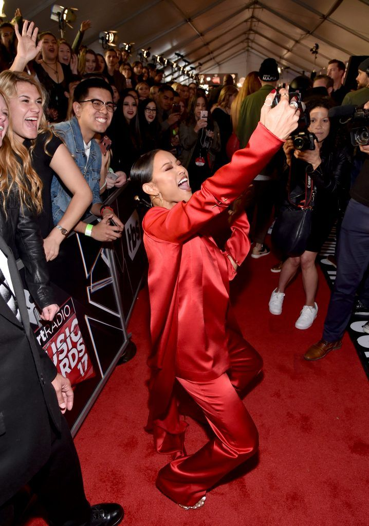 TV personality Karrueche Tran (C) takes a selfie with fans at the 2017 iHeartRadio Music Awards which broadcast live on Turner's TBS, TNT, and truTV at The Forum on March 5, 2017 in Inglewood, California.  (Photo by Frazer Harrison/Getty Images for iHeartMedia)