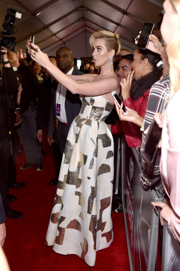 Singer Katy Perry takes a selfie with fans at the 2017 iHeartRadio Music Awards which broadcast live on Turner's TBS, TNT, and truTV at The Forum on March 5, 2017 in Inglewood, California.  (Photo by Frazer Harrison/Getty Images for iHeartMedia)