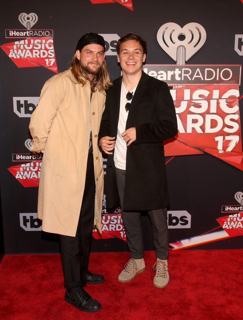 Singer Jake Weary (L) and actor Finn Cole attend the 2017 iHeartRadio Music Awards which broadcast live on Turner's TBS, TNT, and truTV at The Forum on March 5, 2017 in Inglewood, California.  (Photo by Jesse Grant/Getty Images for iHeartMedia)