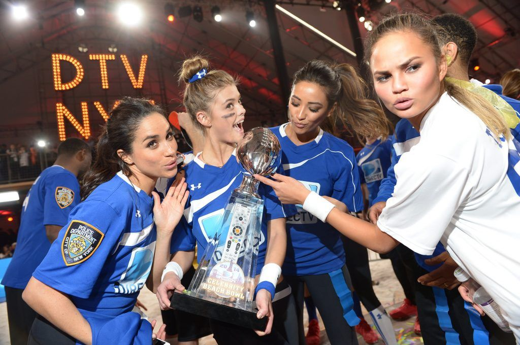 Meghan Markle, Nina Agdal,  Shay Mitchell and Chrissy Teigen participate in the DirecTV Beach Bowl at Pier 40 on February 1, 2014 in New York City.  (Photo by Michael Loccisano/Getty Images for DirecTV)
