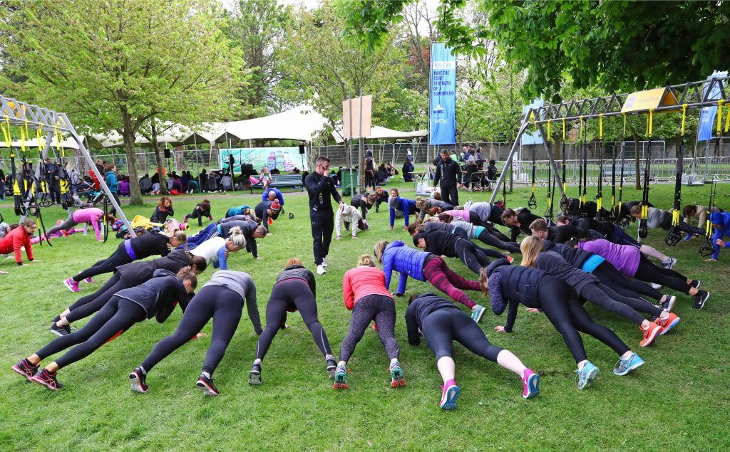 Warming up as over 5,000 people descended on Dublin's Herbert park for WellFest, Ireland's only health, wellness and fitness festival. Pic: Marc O'Sullivan