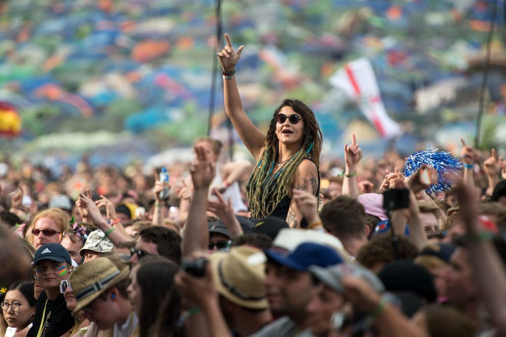Music fans watch Royal Blood perform on the Pyramid Stage at the Glastonbury Festival of Music and Performing Arts on Worthy Farm near the village of Pilton in Somerset, south-west England on June 23, 2017.      (Photo by OLI SCARFF/AFP/Getty Images)