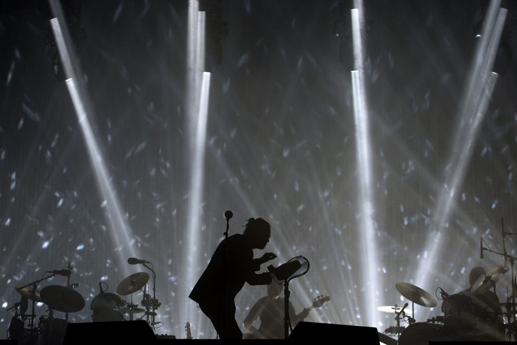 Radiohead perform on the Pyramid Stage at the Glastonbury Festival of Music and Performing Arts on Worthy Farm near the village of Pilton in Somerset, South West England, on June 23, 2017. (Photo by OLI SCARFF/AFP/Getty Images)