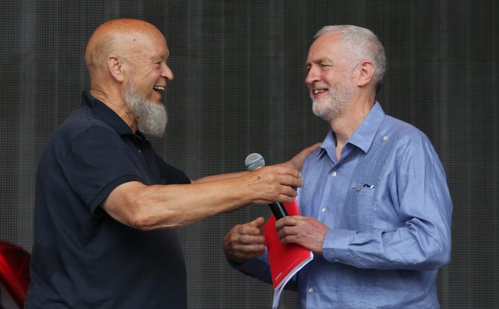 Labour Party leader Jeremy Corbyn (R) and festival founder Michael Eavis address the crowd from the main stage at the Glastonbury Festival site at Worthy Farm in Pilton on June 24, 2017 near Glastonbury, England. (Photo by Matt Cardy/Getty Images)