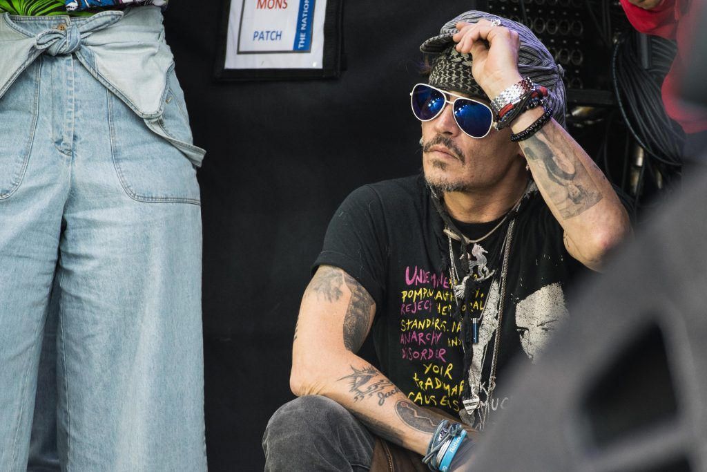 Johnny Depp sits at the side of the Pyramid Stage watching 'Run The Jewels' perform on day 3 of the Glastonbury Festival 2017 at Worthy Farm, Pilton on June 24, 2017 in Glastonbury, England.  (Photo by Ian Gavan/Getty Images)