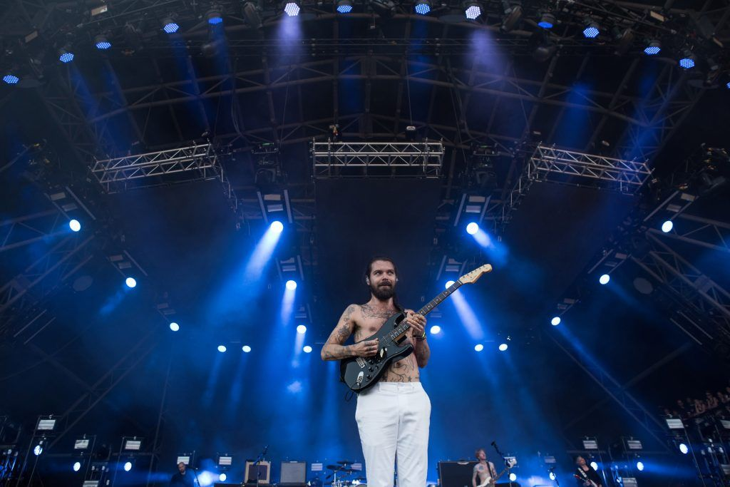 Simon Neil of Biffy Clyro performs on the Pyramid Stage at the Glastonbury Festival of Music and Performing Arts on Worthy Farm near the village of Pilton in Somerset, south-west England, on June 25, 2017. (Photo by OLI SCARFF/AFP/Getty Images)