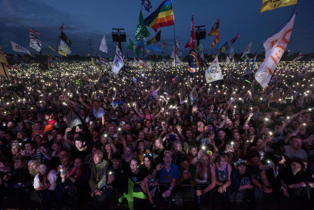 Fans listen as Ed Sheeran performs on the Pyramid Stage at the Glastonbury Festival of Music and Performing Arts on Worthy Farm near the village of Pilton in Somerset, south-west England, on June 25, (Photo by OLI SCARFF/AFP/Getty Images)