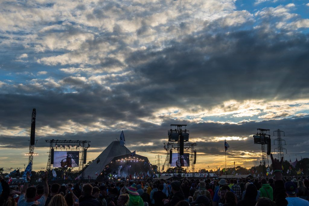 The sun sets as Biffy Clyro perform on the Pyramid Stage at Glastonbury Festival Site on June 25, 2017 in Glastonbury, England. (Photo by Chris J Ratcliffe/Getty Images)